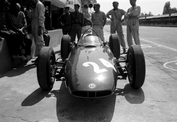 The BRM P48/57 of Graham Hill (GBR) waits for action in the pits.