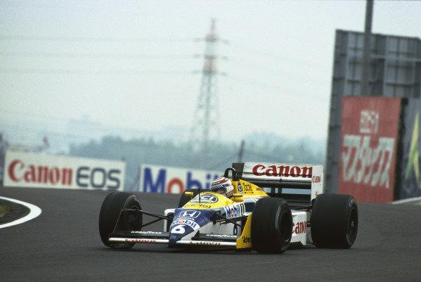 Suzuka, Japan. 29th October - 1st November 1987.Nelson Piquet (Williams FW11 Honda), retired, action.World Copyright - LAT PhotographicRef: 87JAP18