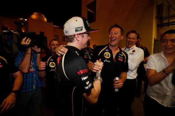 Yas Marina Circuit, Abu Dhabi, United Arab Emirates Sunday 4th November 2012. Kimi Raikkonen, Lotus GP, celebrates victory with his team. World Copyright: Andrew Ferraro/  ref: Digital Image _79P4052