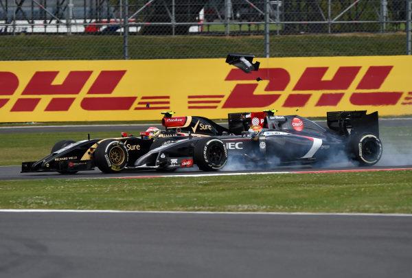 (L to R): Pastor Maldonado (VEN) Lotus E22 about to come together with Esteban Gutierrez (MEX) Sauber C33. Formula One World Championship, Rd9, British Grand Prix, Race Day, Silverstone, England, Sunday 6 July 2014. BEST IMAGE
