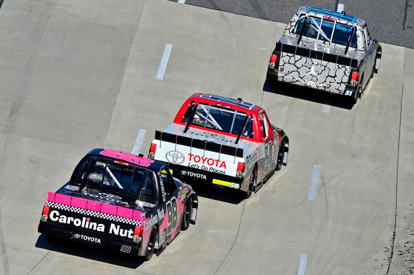 October 25-26, 2013, Martinsville, Virginia USA Denny Hamlin, Darrell Wallace Jr and Johnny Sauter trucks © 2013, Brian Czobat LAT Photo USA