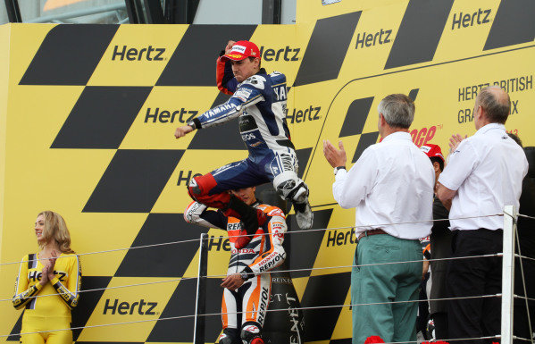 British Grand Prix.  Silverstone, England. 30th August - 1st September 2013.  Jorge Lorenzo, Yamaha, celebrates victory with his traditional leap off the podium.  Ref: IMG_2512a. World copyright: Kevin Wood/LAT Photographic