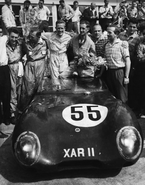 Le Mans, France. 22 - 23 June 1957.Cliff Allison/Keith Hall (Lotus XI-Climax), 14th position overall and 1st position, in class, celebrate with Colin Chapman and mechanics in the pits, portrait. World Copyright: LAT Photographic.Ref:  B/WPRINT.