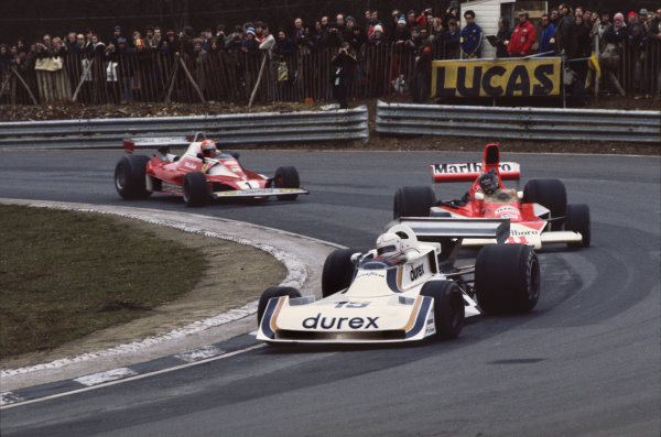 Brands Hatch, England. 16th -18th July 1976Alan Jones (Surtees TS19-Ford), 5th position, leads James Hunt (McLaren M23-Ford), Disqualified and Niki Lauda (Ferrari 312T2), 1st position, action. World Copyright: LAT Photographic.Ref:  76GB