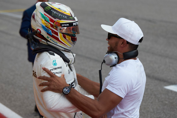 Circuit of the Americas, Austin, Texas, United States of America. Saturday 21 October 2017. Lewis Hamilton, Mercedes AMG, celebrates with his brother Nick, after securing pole position. World Copyright: Steve Etherington/LAT Images  ref: Digital Image SNE18979