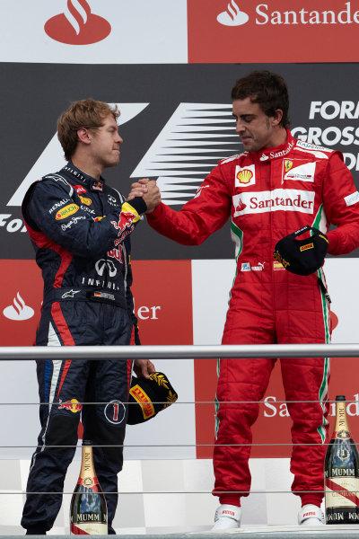 Hockenheimring, Hockenheim, Germany 22nd July 2012 Fernando Alonso, Ferrari, 1st position, and Sebastian Vettel, Red Bull Racing, 2nd position, on the podium. World Copyright: Steve Etherington/LAT Photographic ref: Digital Image HC5C5867 copy