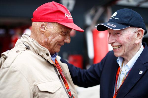 Silverstone, Northamptonshire, UK Sunday 10 July 2016. Niki Lauda with John Surtees. World Copyright: Glenn Dunbar/LAT Photographic ref: Digital Image _V2I0031
