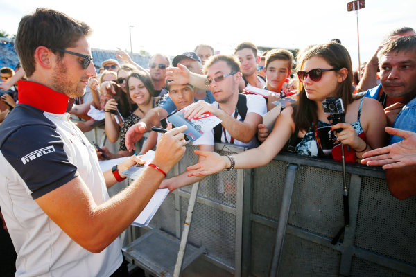 Hungaroring, Budapest, Hungary. Thursday 21 July 2016. Romain Grosjean, Haas F1 signs autographs for his fans. World Copyright: Andrew Hone/LAT Photographic ref: Digital Image _ONZ0660