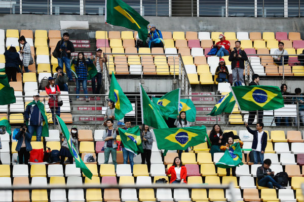 Shanghai International Circuit, Shanghai, China.  Friday 07 April 2017. Chinese fans wave Brazilian flags. World Copyright: Glenn Dunbar/LAT Images ref: Digital Image _X4I6182