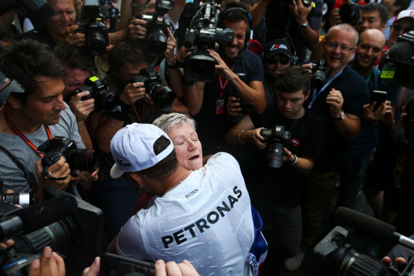 Autodromo Hermanos Rodriguez, Mexico City, Mexico. Sunday 29 October 2017. Lewis Hamilton, Mercedes AMG, celebrates with his mum Carmen Larbalestier, surrounded by photographers and media,after securing his 4th world drivers championship title, and third with Mercedes. World Copyright: Charles Coates/LAT Images  ref: Digital Image DJ5R7916