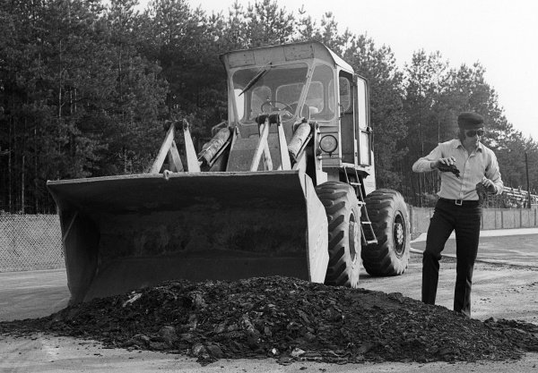 Race winner Jackie Stewart (GBR) oversees resurfacing work carried out to the circuit which threatened the running of the GP.