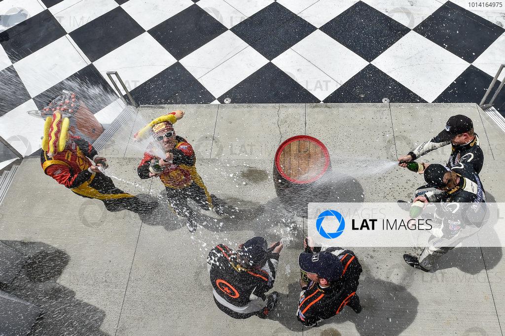 26-28 June, 2014, Watkins Glen, New York USA 75, Honda, Civic Si, ST, Kyle Gimple, Ryan Eversley, 5, Mazda, MX-5, ST, Stevan McAleer, Chad McCumbee, 42, Porsche, Cayman, ST, Wayne Nonnamaker, Will Nonnamaker celebrate the win on the podium with champagne  ?2014 Scott R LePage LAT Photo USA