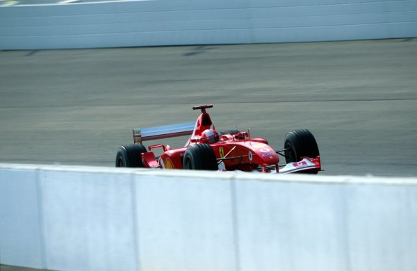Michael Schumacher (GER) powers his Ferrari F2002 around the Indy banking.