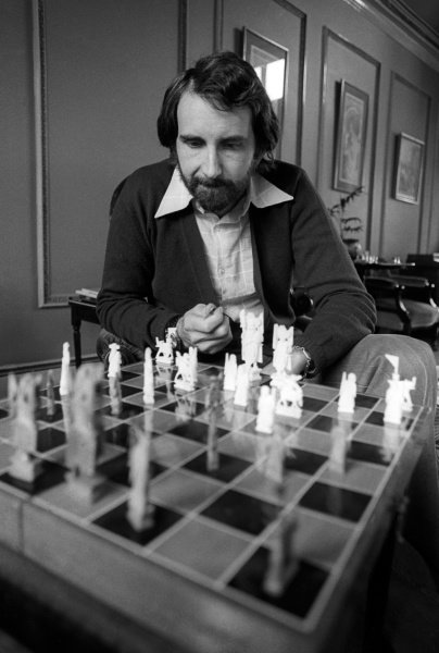 John Watson (GBR) plays a game of chess at home.Lifestyle Feature, 1975 Formula One World Championship.