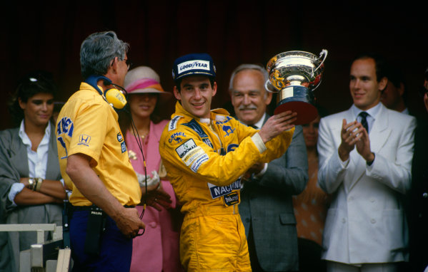 1987 Monaco Grand Prix. Monte Carlo, Monaco. 28th - 31st May 1987.  Ayrton Senna (Lotus 99T Honda),1st position, with Lotus boss Peter Warr who collected the constructors prize, podium, portrait.World Copyright: LAT Photographic.Ref:  Colour Transparency.
