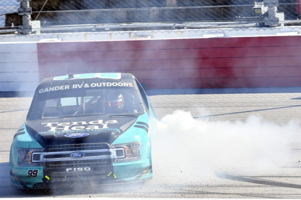 #99: Ben Rhodes, ThorSport Racing, Ford F-150 Tenda celebrates his win with a burnout