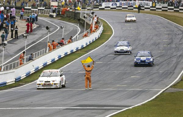 Robb Gravett, Trakstar Motorsport, Ford Sierra RS500, lines up in pole position on the grid.