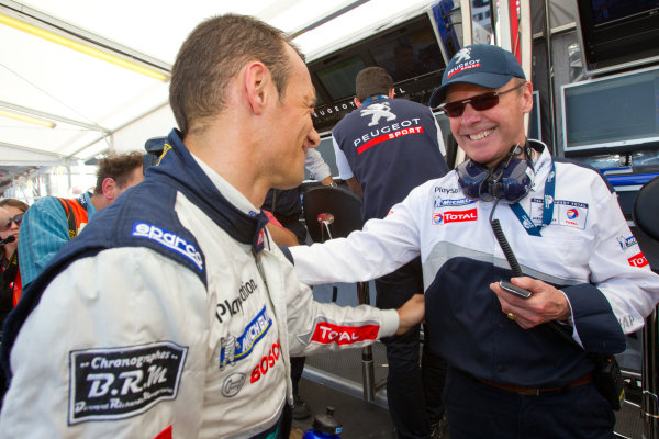 P1 pole winner Stephane Sarrazin celebrates with Peugeot Sport director Olivier Quesnel