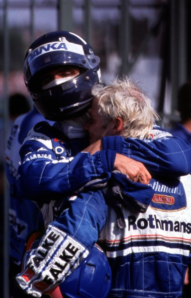 1997 Hungarian Grand Prix.Hungaroring, Budapest, Hungary.8-10 August 1997.Damon Hill (Arrows Yamaha) and Jacques Villeneuve (Williams Renault) celebrate in parc ferme. Villeneuve passed Hill on the last lap to win.World Copyright - LAT Photographic