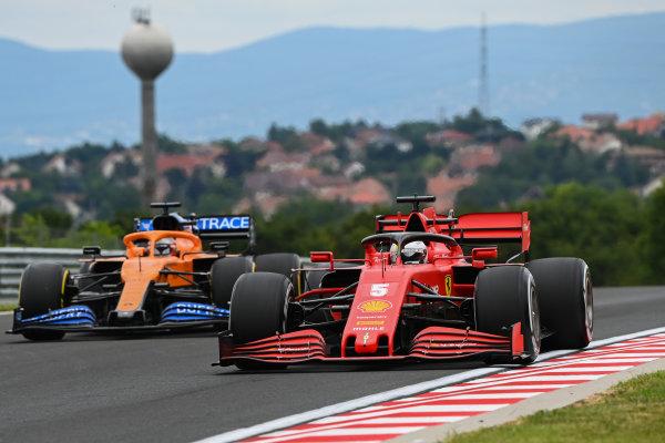 Sebastian Vettel, Ferrari SF1000, leads Carlos Sainz, McLaren MCL35