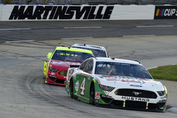 Kevin Harvick, Stewart-Haas Racing Ford Hunt Brothers Pizza, leads a pack of cars, Copyright: Jared C. Tilton/Getty Images.