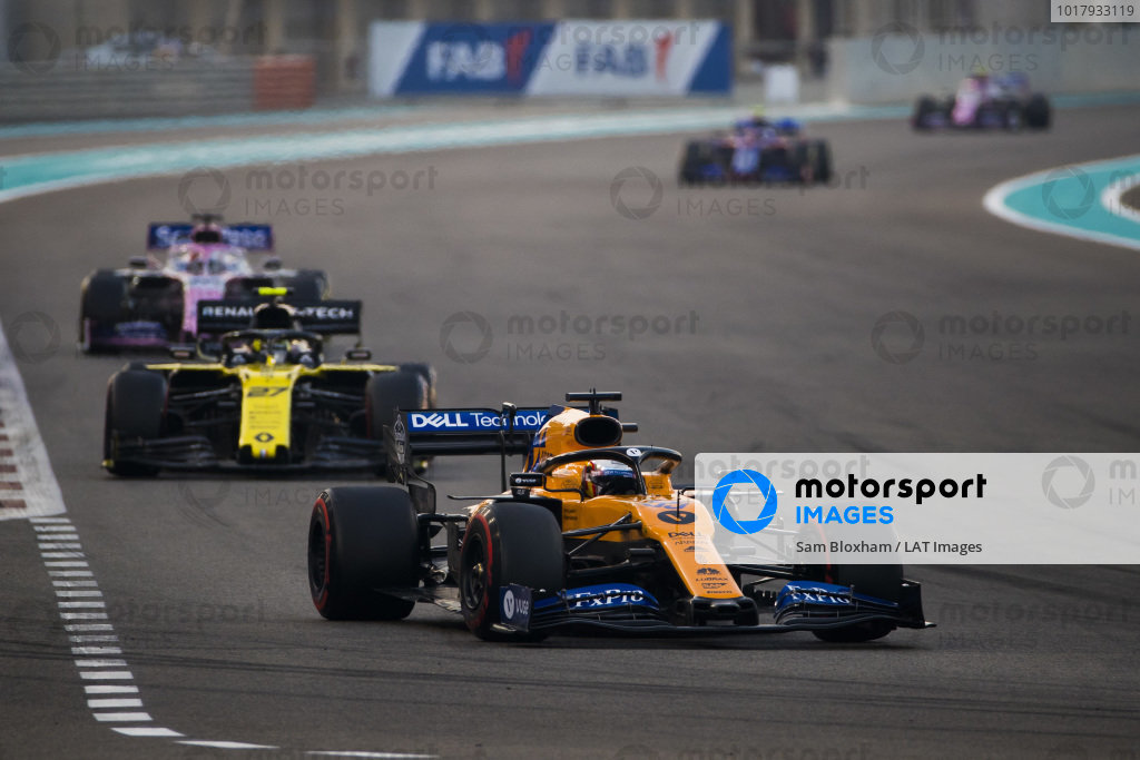 Carlos Sainz Jr., McLaren MCL34, leads Nico Hulkenberg, Renault R.S. 19, and Sergio Perez, Racing Point RP19
