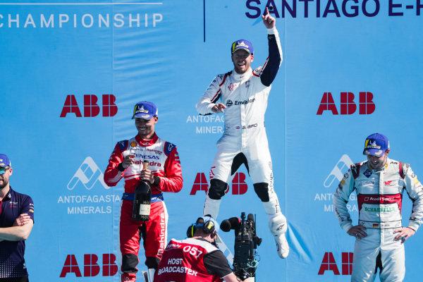Sam Bird (GBR), Envision Virgin Racing, 1st position, celebrates on the podium alongside Pascal Wehrlein (DEU), Mahindra Racing, 2nd position, and Daniel Abt (DEU), Audi Sport ABT Schaeffler, 3rd position.