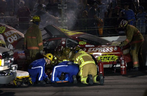 2002 NASCAR,Richmond Intl. Raceway,Sept 06-07, 20022002 NASCAR, Richmond,Va . USA -EMT's working on an injured Derrike cope after a hard hit in BGN action,Copyright-Robt LeSieur2002LAT Photographic