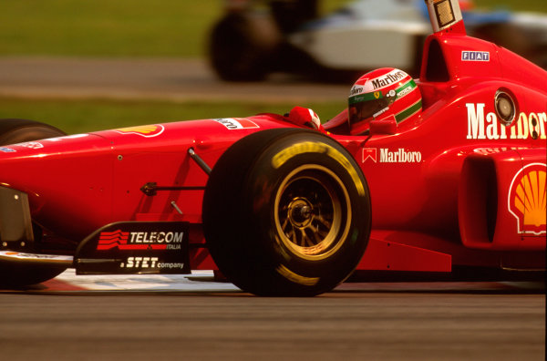 Montreal, Quebec, Canada.14-16 June 1996.Eddie Irvine (Ferrari F310). He exited the race with a broken right front pushrod on lap 2.Ref-96 CAN 06.World Copyright - LAT Photographic