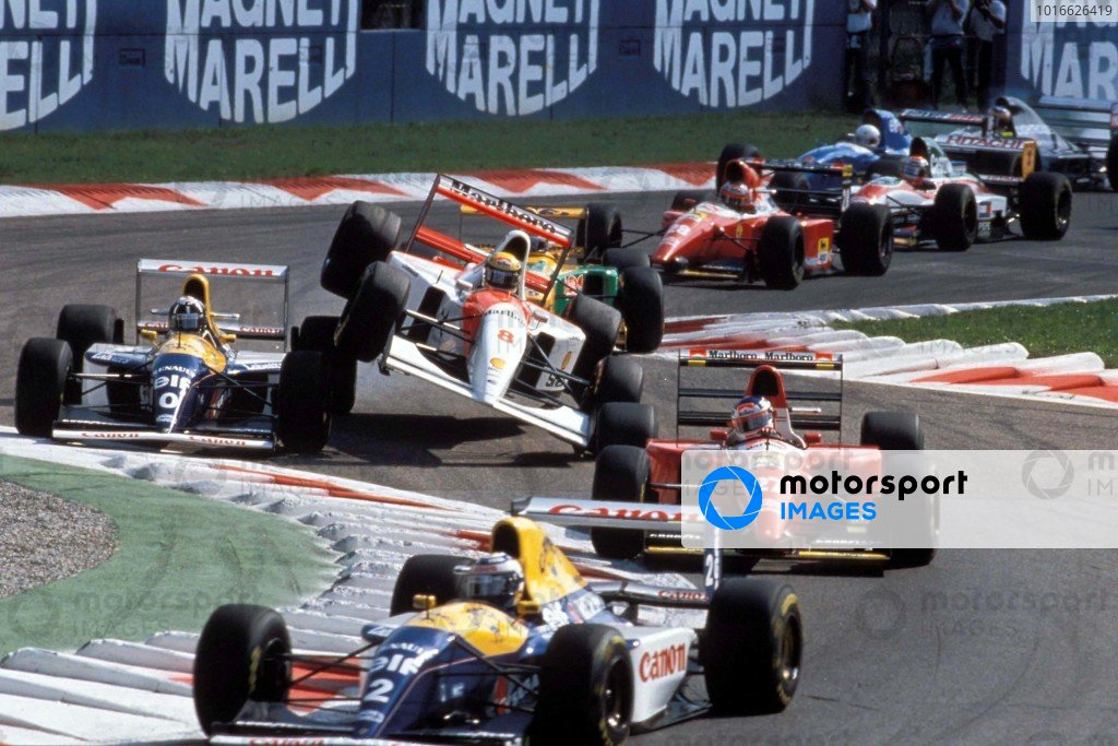 Alain Prost, Williams FW15C Renault, leads from Jean Alesi, Ferrari F93A, as Ayrton Senna, McLaren MP4-8 Ford, bounces up over Damon Hill, Williams FW15C Renault, at the start.