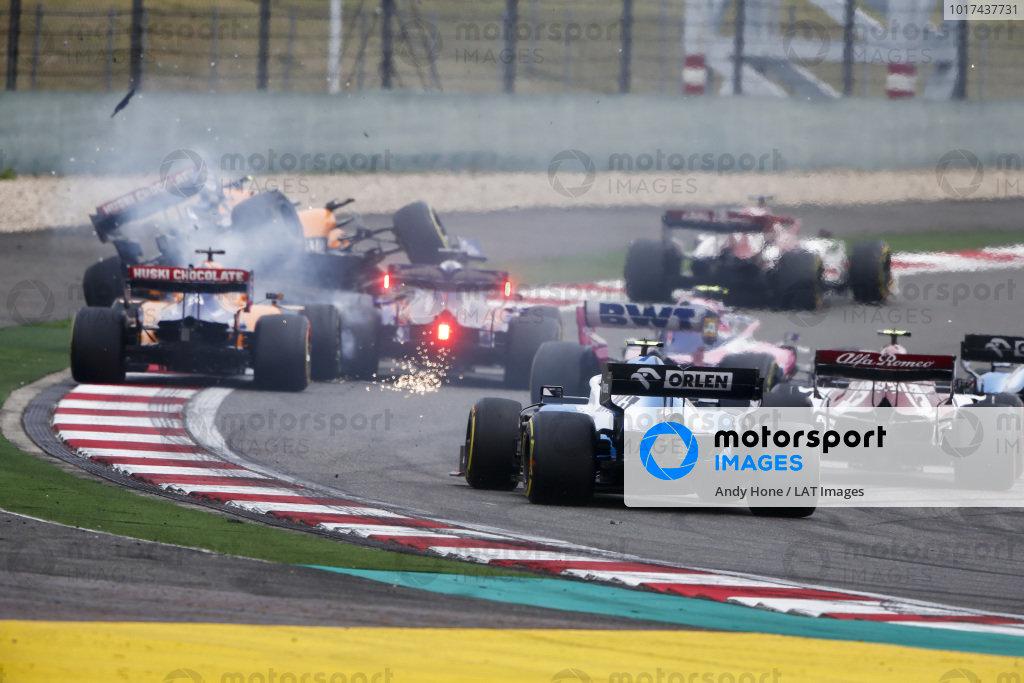 Lando Norris, McLaren MCL34 in the air after contact from Daniil Kvyat, Toro Rosso STR14 with Carlos Sainz Jr., McLaren MCL34, Lance Stroll, Racing Point RP19 and Robert Kubica, Williams FW42 behind