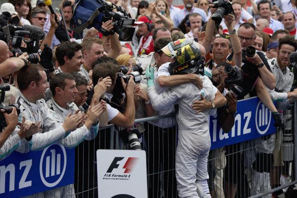 Nico Rosberg hugs Dieter Zetsche in parc ferme.