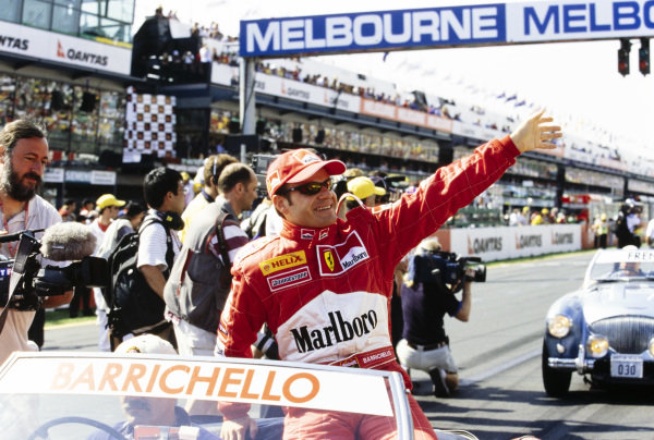 Rubens Barrichello waves to the crowd on the drivers' parade.