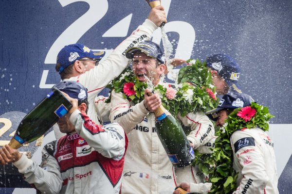 LMP1 podium: class and overall winners #2 Porsche Team Porsche 919 Hybrid: Romain Dumas takes a champagne shower