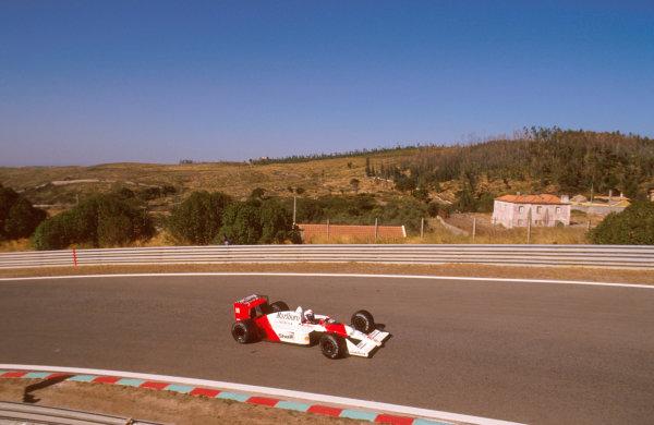 Estoril, Portugal.23-25 September 1988.Alain Prost (McLaren MP4/4 Honda) 1st position.Ref-88 POR 20.World Copyright - LAT Photographic