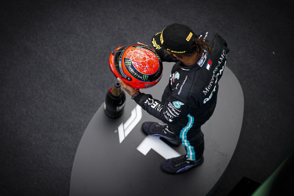 Lewis Hamilton, Mercedes-AMG Petronas F1, 1st position, on the podium with the helmet of Michael Schumacher that was presented to him by Mick Schumacher upon equalling Michaels record number of 91 wins