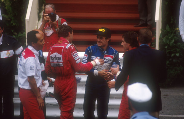 1990 Monaco Grand Prix.Monte Carlo, Monaco.25-27 May 1990.Ayrton Senna, 1st position and Gerhard Berger, 3rd position (both McLaren Honda) congratulate Jean Alesi (Tyrrell Ford) on his 2nd position finish.Ref-90 MON 09.World Copyright - LAT Photographic