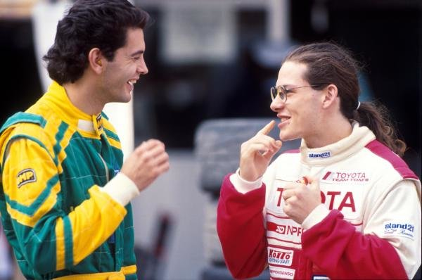 Jacques Villeneuve (CDN) (Right) talks to a fellow competitor.