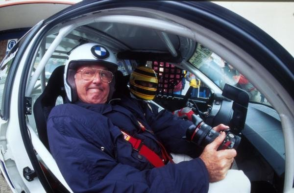 British TV commentator Murray Walker about to be taken for the ride of his life. British Touring Car Championship Press Day, Donington Park, 20 March 1996