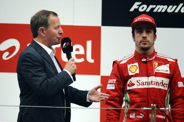 (L to R): Martin Brundle (GBR) Sky TV interviews second placed Fernando Alonso (ESP) Ferrari on the podium. Formula One World Championship, Rd17, Indian Grand Prix, Buddh International Circuit, Greater Noida, New Delhi, India, Race, Sunday 28 October 2012.