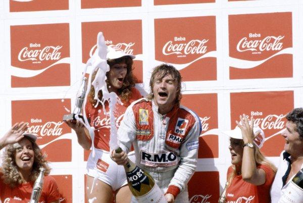 1980 Brazilian Grand Prix.Interlagos, Sao Paulo, Brazil. 25-27 January 1980.Rene Arnoux (Renault RE20), 1st position. Podium, champagne.World Copyright: LAT PhotographicRef: 35mm transparency 80BRA03