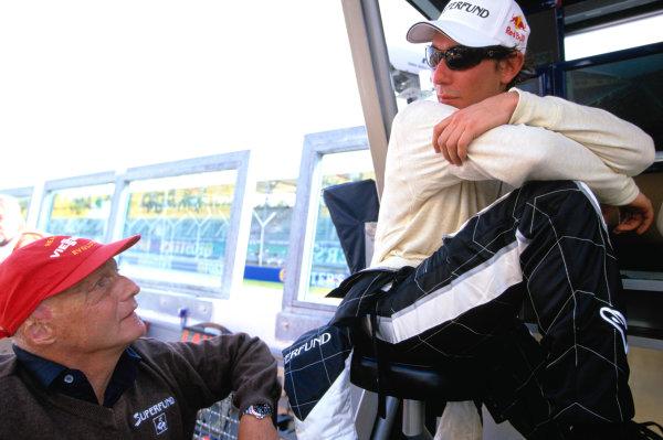 2004 Formula 3000 Championship (F3000)Imola, Italy.April 24th 2004Mathius Lauda talks to his father Niki Lauda. Portrait. World Copyright: Charles Coates/LAT Photographic.Ref: 35mm Image A12.