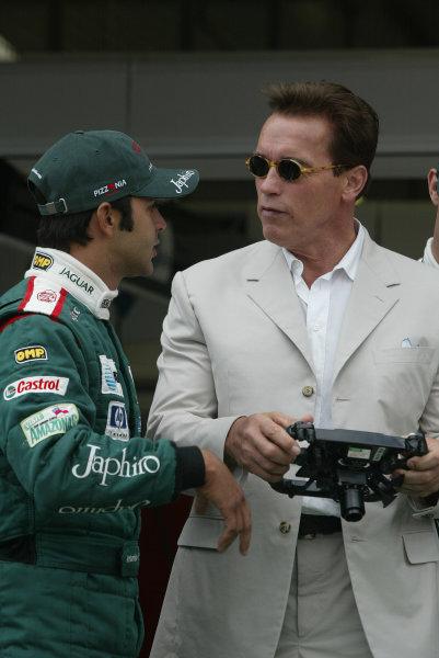2003 British Grand Prix - Sunday Race,2003 British Grand Prix Silverstone, Britain. 20th July 2003.Arnold Schwartzenegger and Antonio Pizzonia.World Copyright: Steve Etherington/LAT Photographic ref: Digital Image Only