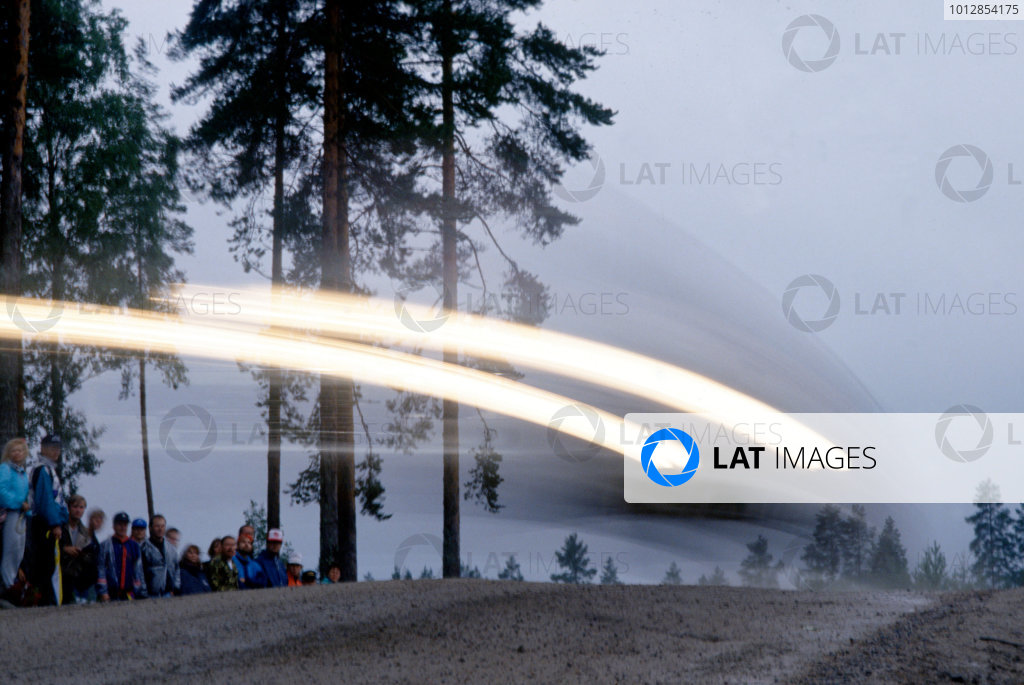 FIA World Rally Championship.1000 Lakes, Finland. 23rd - 26th August 1990.Fans watch on as a rally car speeds past. Action. World Copyright:LAT Photographic.Ref:35mm Image