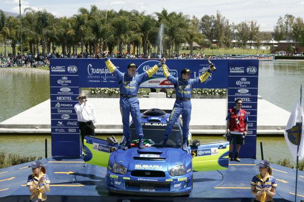 2005 FIA World Rally Champs. Round threeRally Mexico.10th - 13th March 2005.Petter Solberg & Phil Mills, Subaru, podiumWorld Copyright: McKlein/LAT