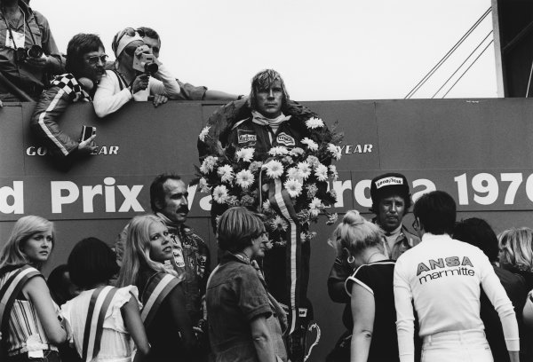 Zandvoort, Holland. 27th - 29th August 1976. James Hunt (McLaren M23-Ford), 1st position, celebrates on the podium with Clay Regazzoni (Ferrari 312T2), 2nd position and Mario Andretti (Lotus 77-Ford), 3rd position, portrait.  World Copyright: LAT Photographic.  Ref:  9055 - 19-19A.
