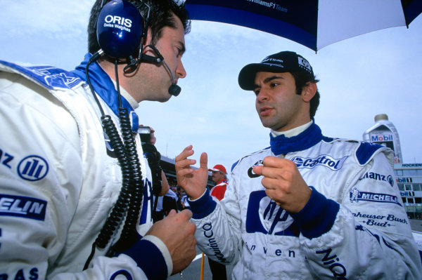 2004 German Grand PrixHockenheim, Germany. 23rd - 25th July.Antonio Pizzonia, BMW Williams FW26 talks to a team member before the start of the race. World Copyright:Steven Tee/LAT Photographi--c Ref:35mm Image:A13