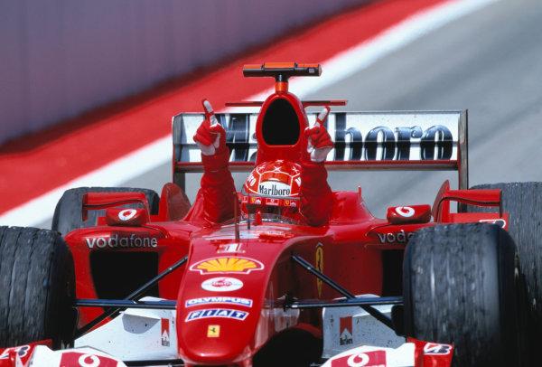 2004 Spanish Grand Prix. Circuit de Catalunya, Barcelona, Spain. 7th - 9th May.  Michael Schumacher, Ferrari F2004 celebrating victory on his parade lap. World Copyright: Charles Coates/LAT Photographic  ref: 35mm Image A21