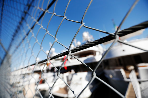 Monte Carlo, Monaco. Wednesday 20 May 2015. Yachts behind a fence in the harbour. World Copyright: Charles Coates/LAT Photographic. ref: Digital Image _N7T0734