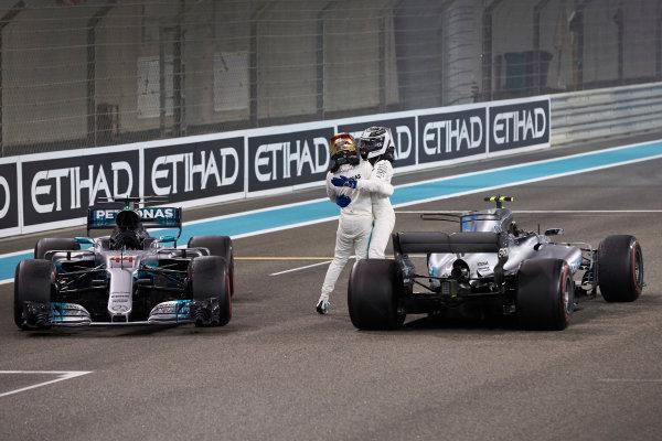 Yas Marina Circuit, Abu Dhabi, United Arab Emirates. Sunday 26 November 2017. Lewis Hamilton, Mercedes AMG, 2nd Position, and Valtteri Bottas, Mercedes AMG, 1st Position, celebrate after the race. World Copyright: Steve Etherington/LAT Images  ref: Digital Image SNE21176